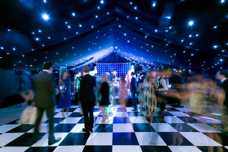 Black starcloth linings over black & white dancefloor